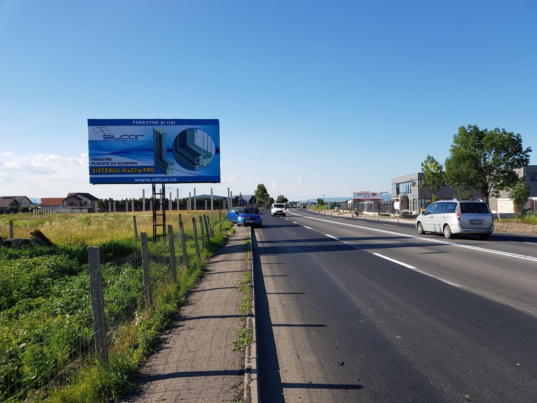 Panou publicitar de tip Unisign la ieșirea din oras dimensiuni mari.