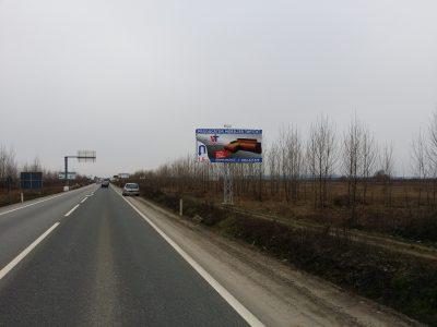 Panou publicitar unipol la intrare în oraș